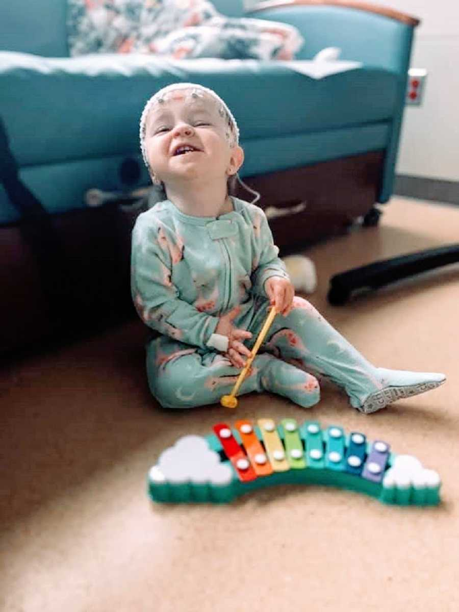 A little girl with Dravet Syndrome plays with a xylophone