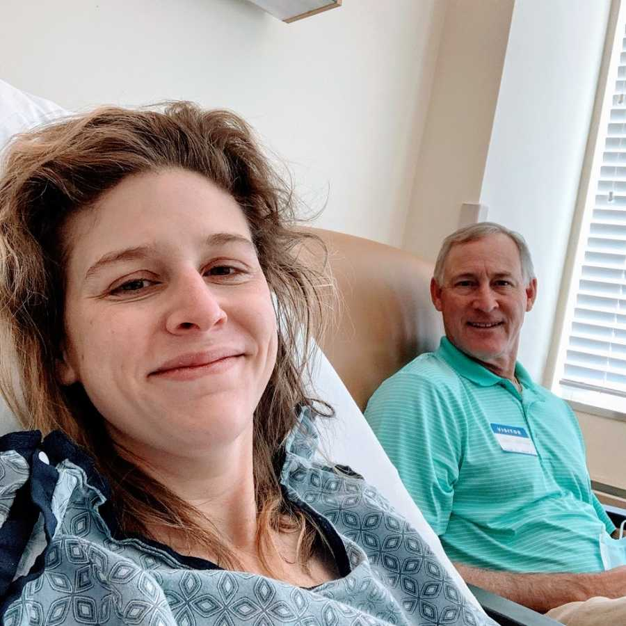A woman and her father sit together in a hospital