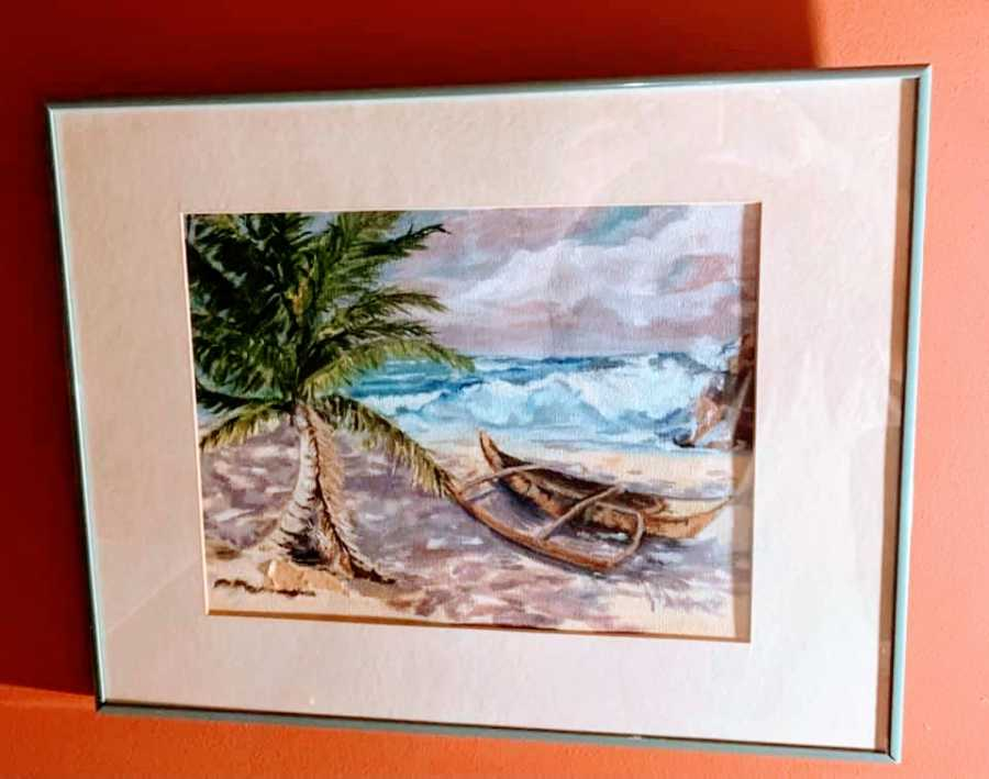 A painting of a boat washed on shore