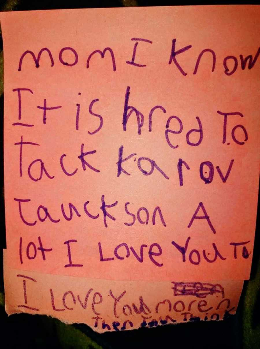 A handwritten note in purple marker from a girl to her mom
