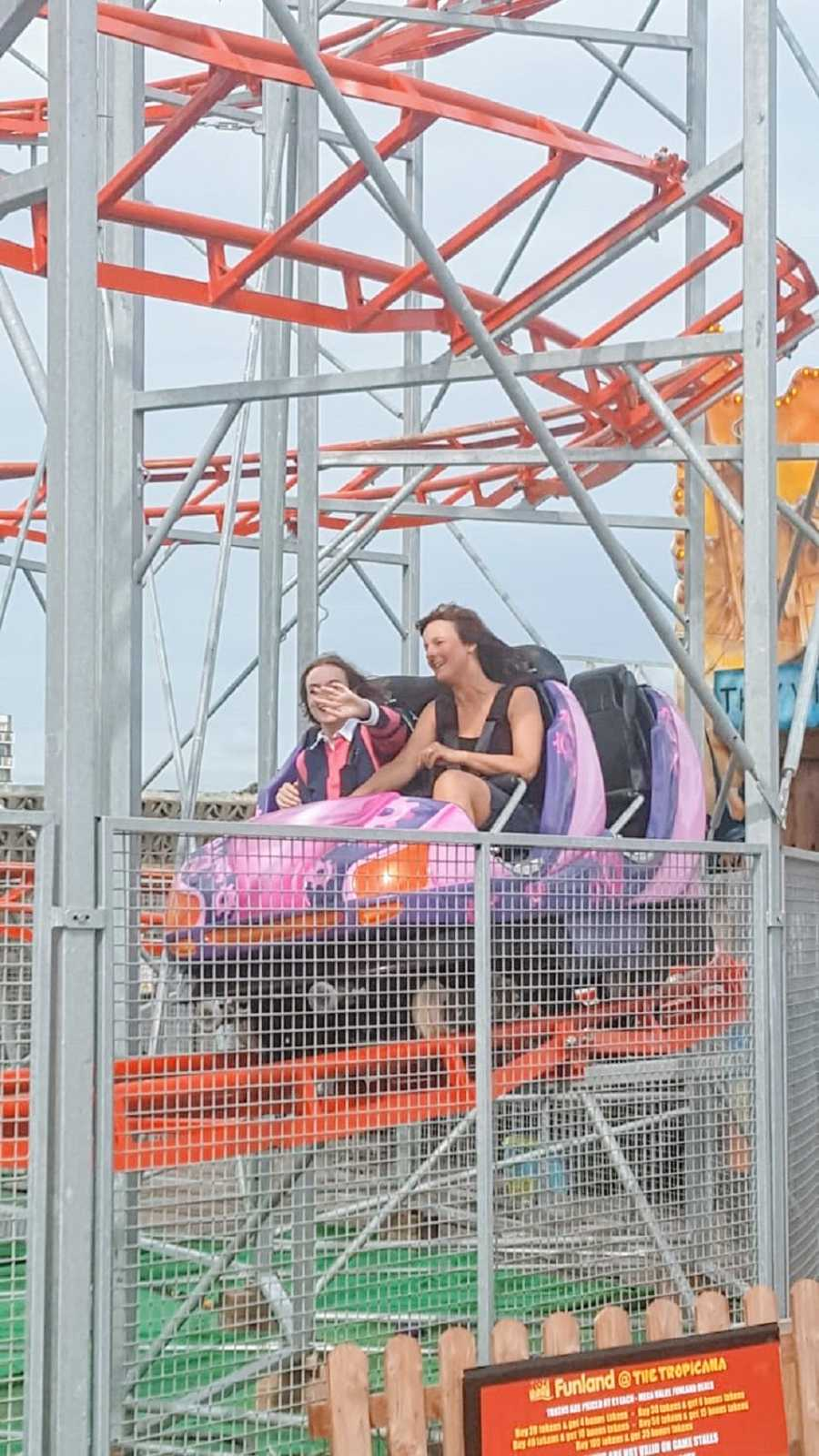 A woman and her mother riding a roller coaster