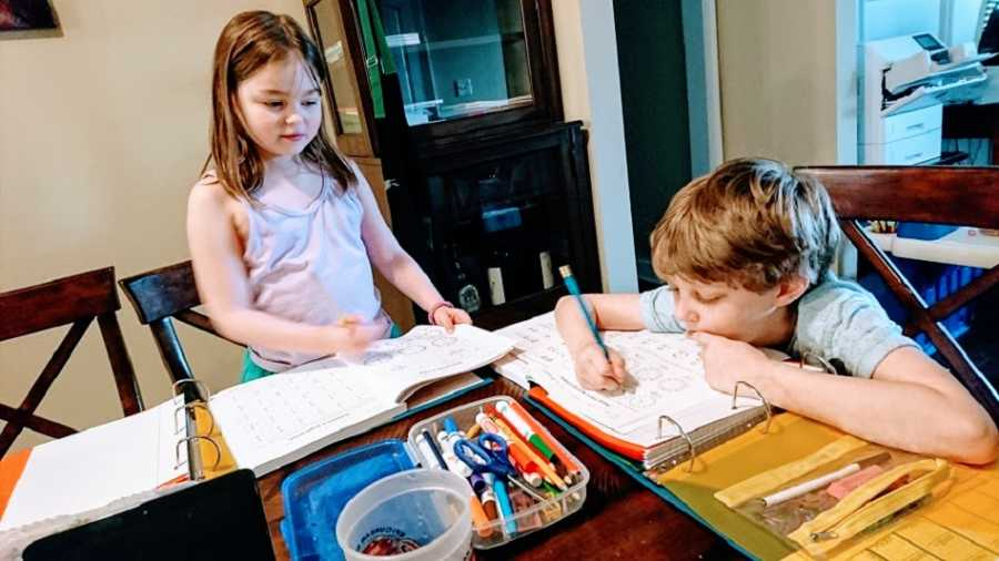 A pair of children work on homework at a table