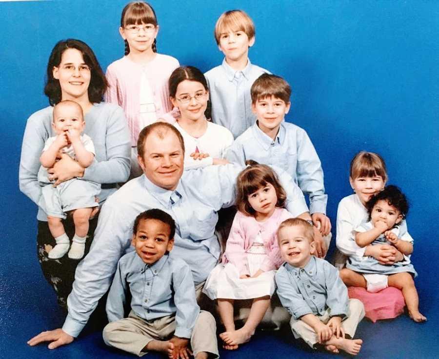 Parents sit with their ten children