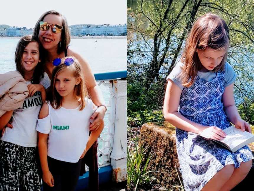 A mother stands with her two children and a girl with autism reads a book outdoors