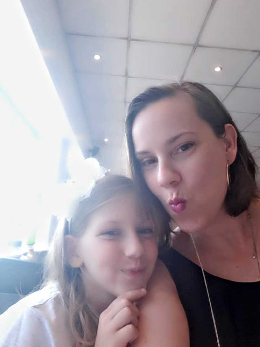 A mother and her daughter with autism make faces at the camera