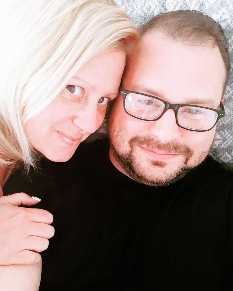 A woman and her husband, who is wearing glasses