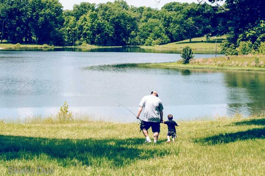 A father takes his son to a lake in the middle of a field