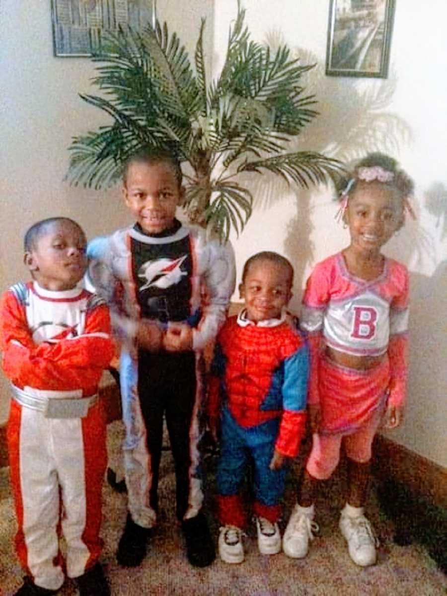 Four siblings wear superhero costumes for Halloween
