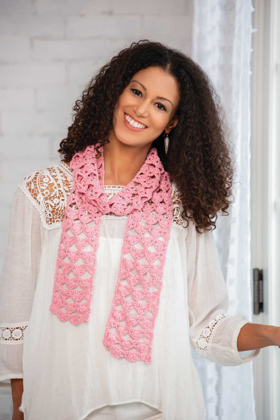 Woman wearing a handmade, pink scarf