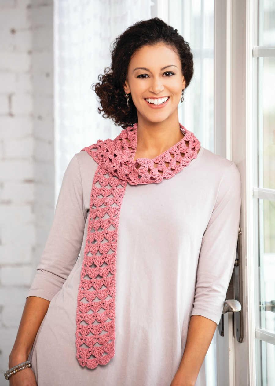 woman wearing pink, handmade scarf
