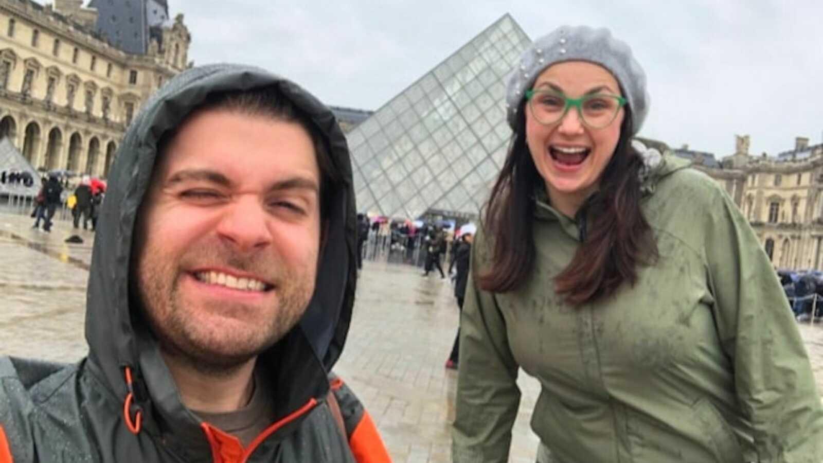 Couple taking selfie in rain coats in France