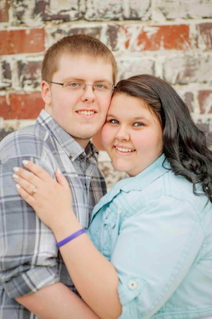High school sweethearts take couple's photos together, both wearing button-down shirts