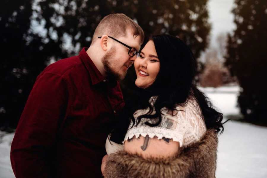 Young married couple take sweet, intimate winter-themed photos in the snow