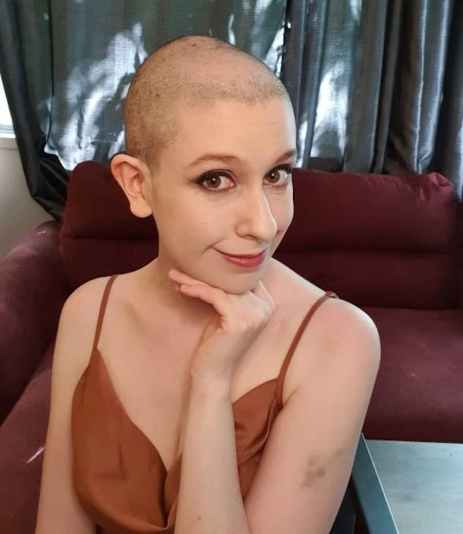 bald woman smiling