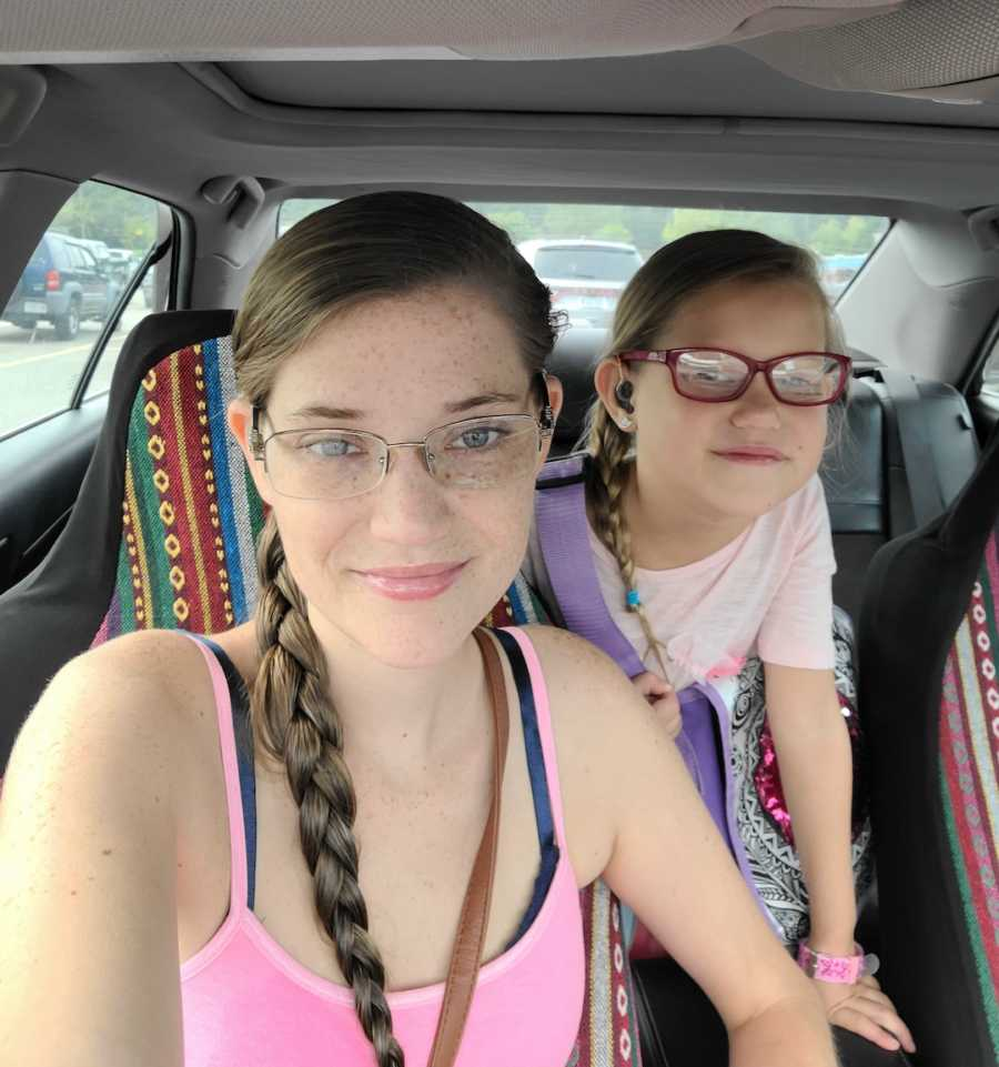 mom and daughter in the car