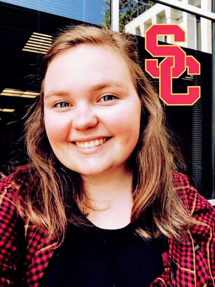 Young college student takes a selfie with a University of Southern California filter
