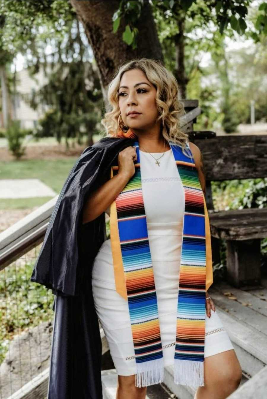 First generation college student takes graduation pictures at Sonoma State University
