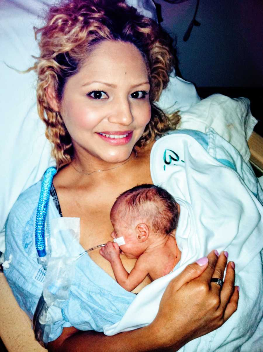 Mom holds her rainbow baby after suffering multiple miscarriages due to low levels of progesterone