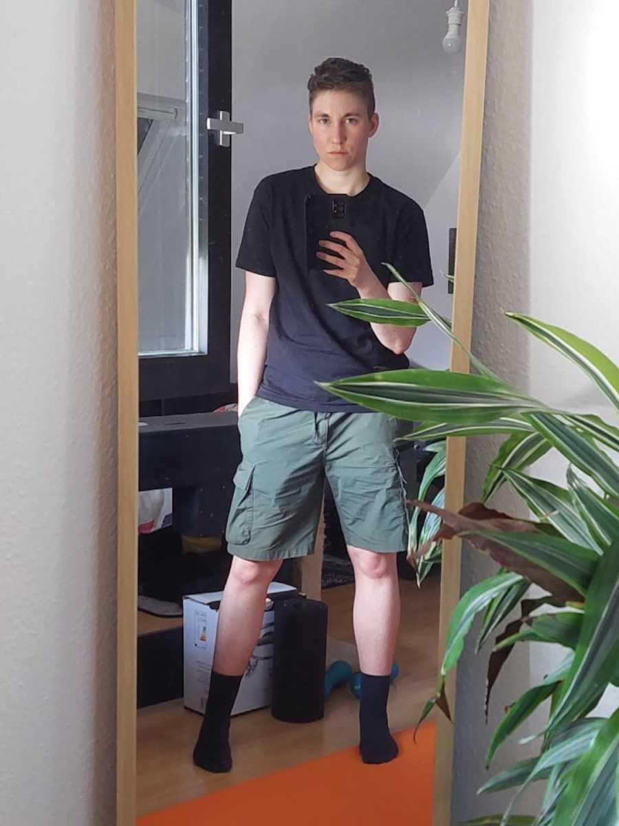 man taking a mirror selfie