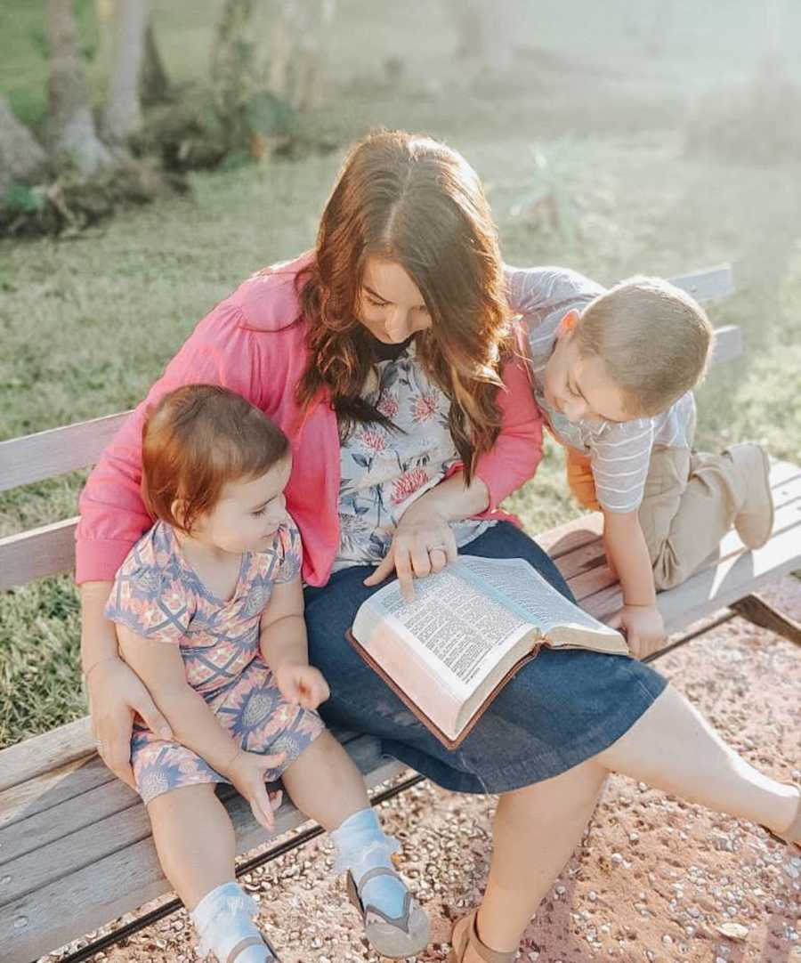 mom reading to her two kids