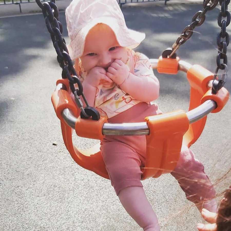 baby girl in a swing