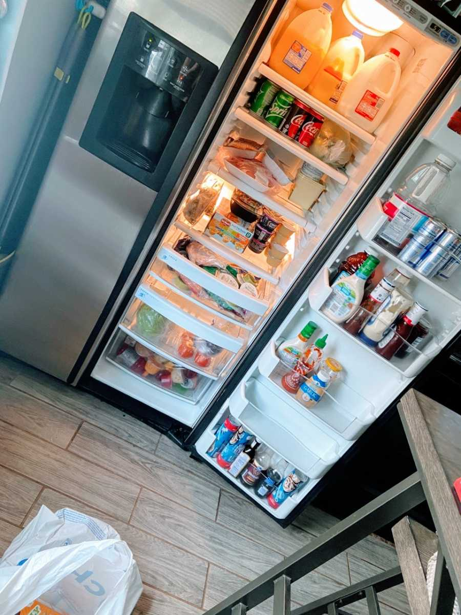 Stay at home mom takes a photo of her stocked up fridge