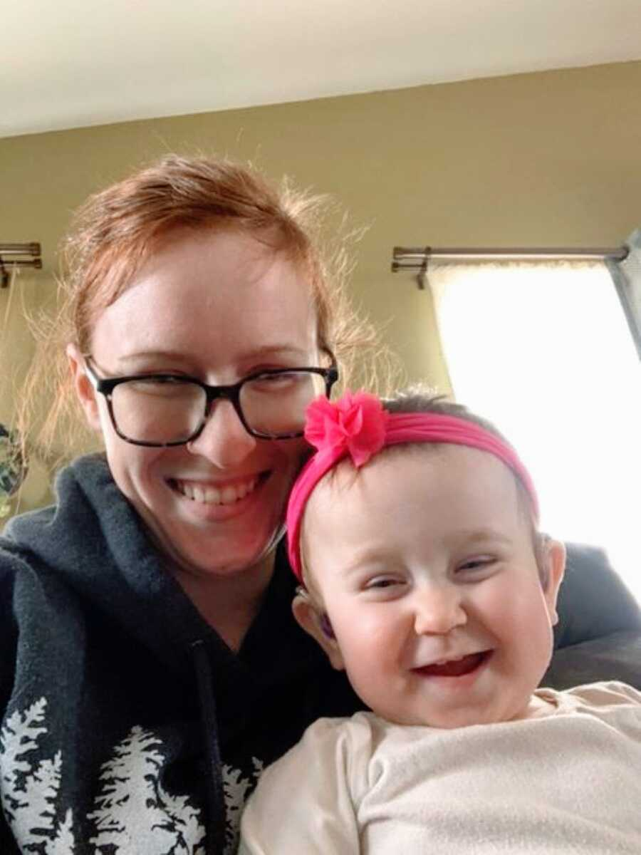 Special needs mom smiles big as she takes a selfie with her daughter born with hydrocephalus and ANSD