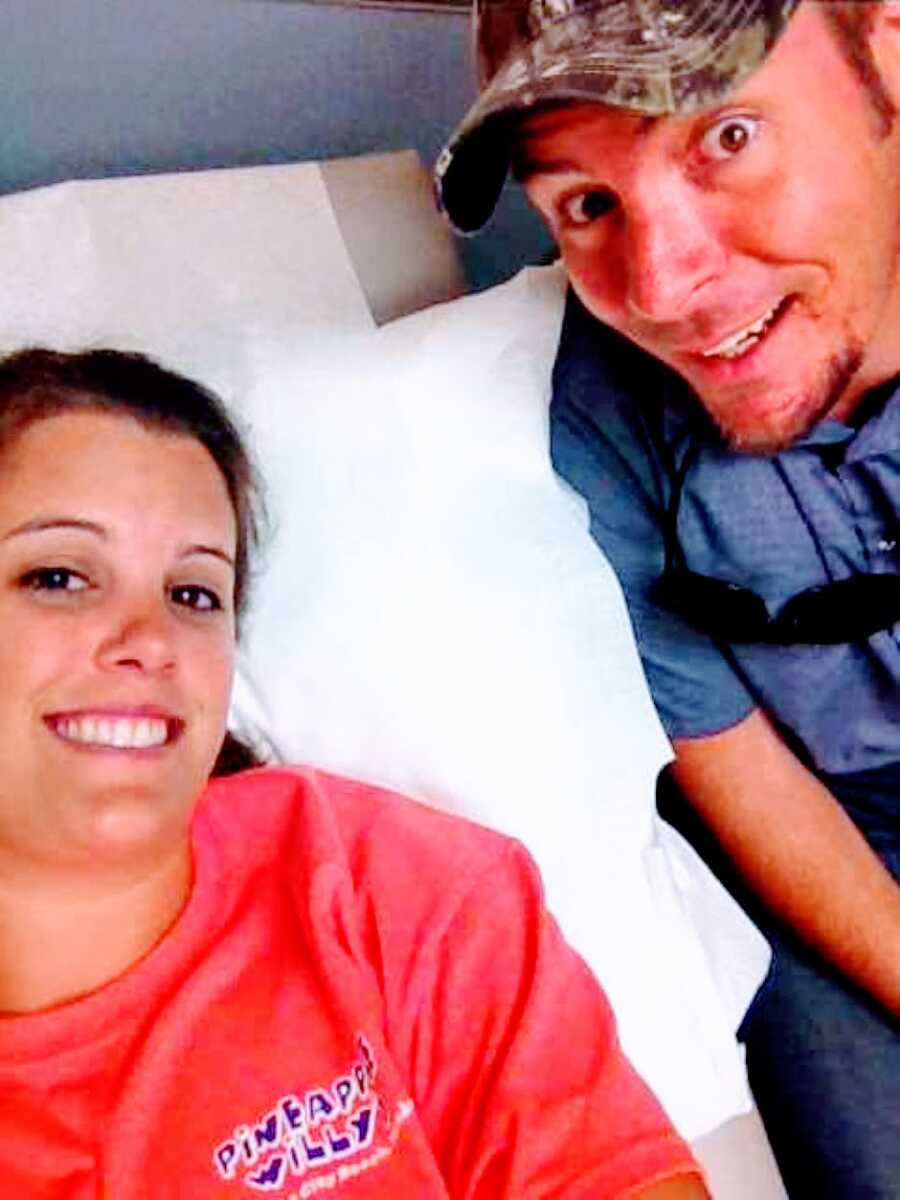 Couple take selfie together while at a fertility specialist getting tests done to figure out why they are struggling with infertility