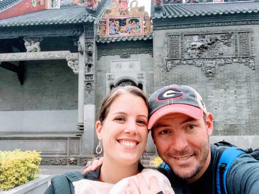 Couple adopting a son from China go sightseeing while waiting to finalize the adoption