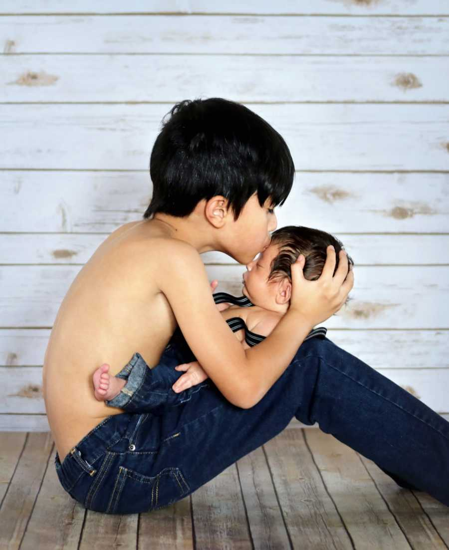 Young special needs brothers share intimate moment during photoshoot