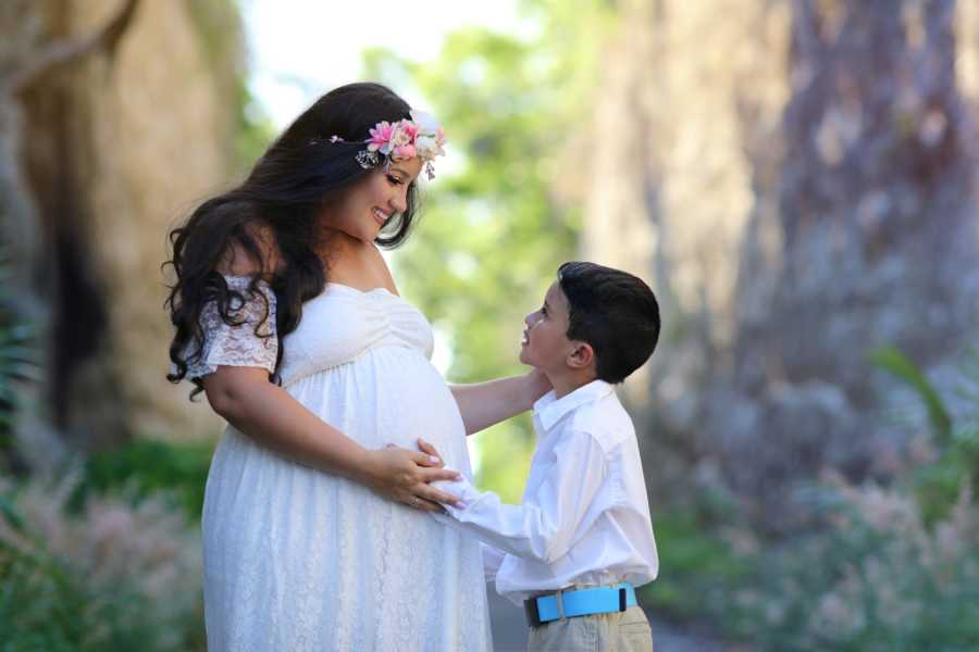 Mom and son share intimate moment during maternity photoshoot as they feel the baby kick
