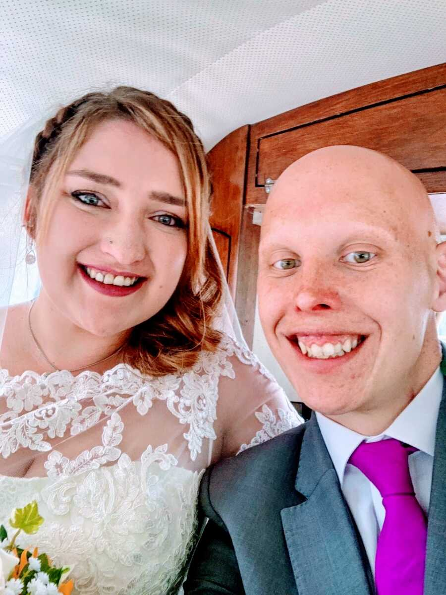Newlyweds take a selfie together after their wedding reception