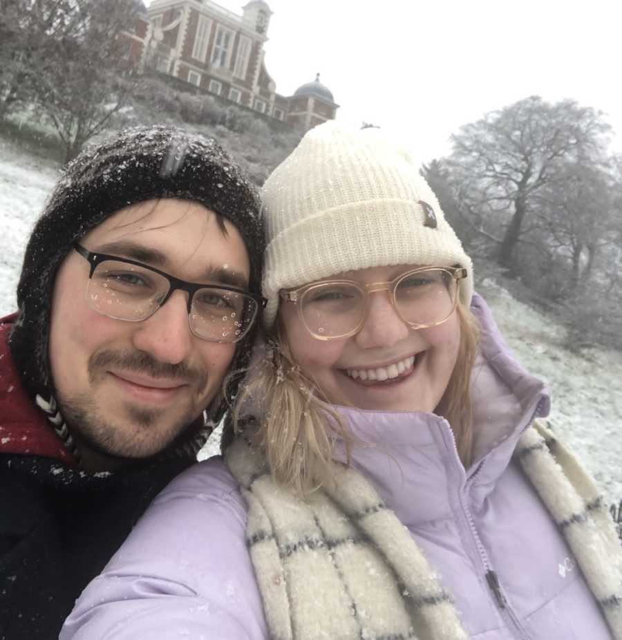 couple smiling together in the snow