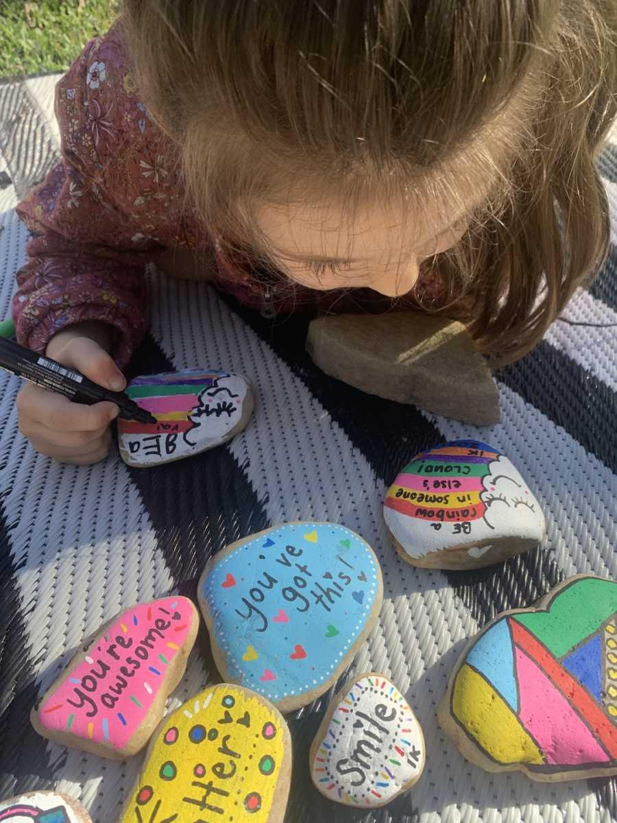 kid making kindness rocks