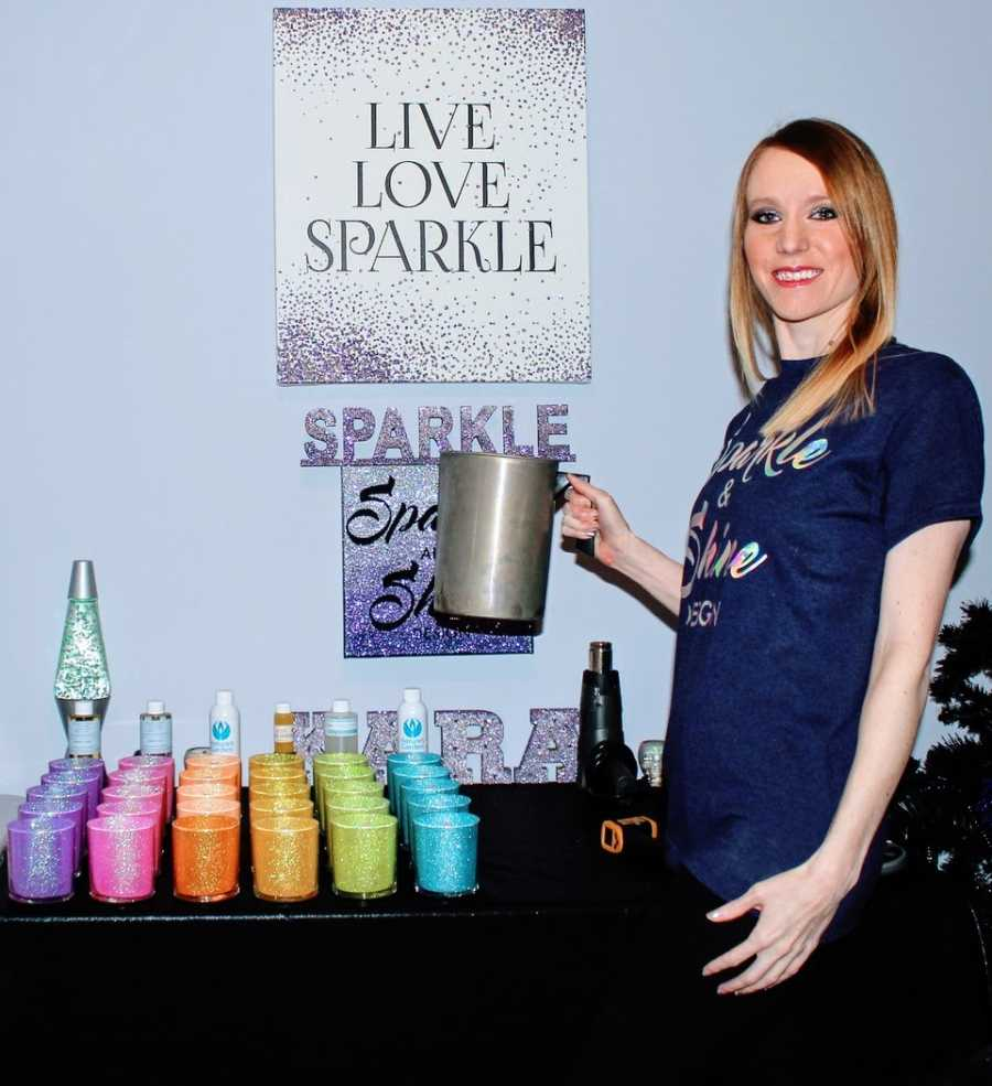 """Woman takes a photo with some of her homemade products for her business """"Sparkle and Shine"""""""