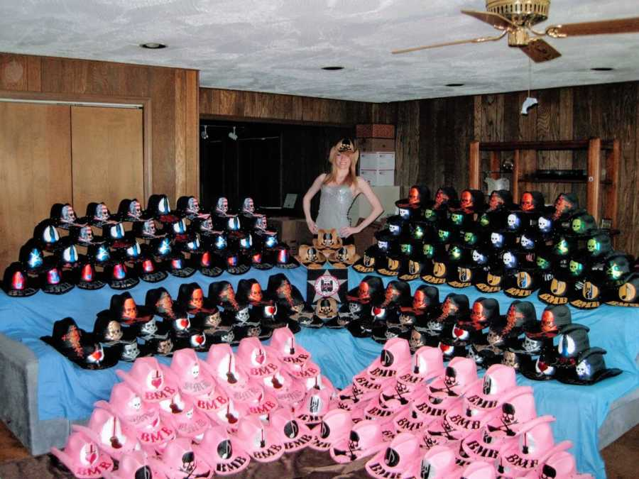 Woman who made hats for Bret Michaels smiles in front of dozens of hats she made