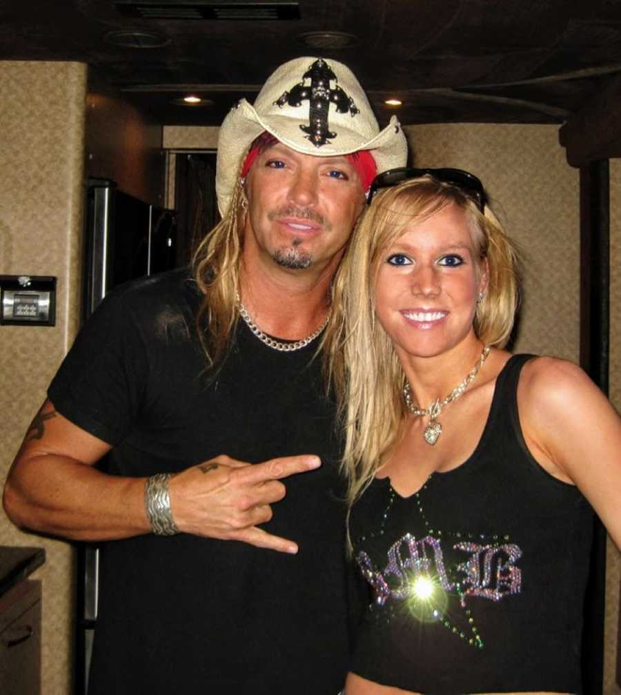Woman who made hats for Bret Michaels takes a photo with him while he wears one of her hats