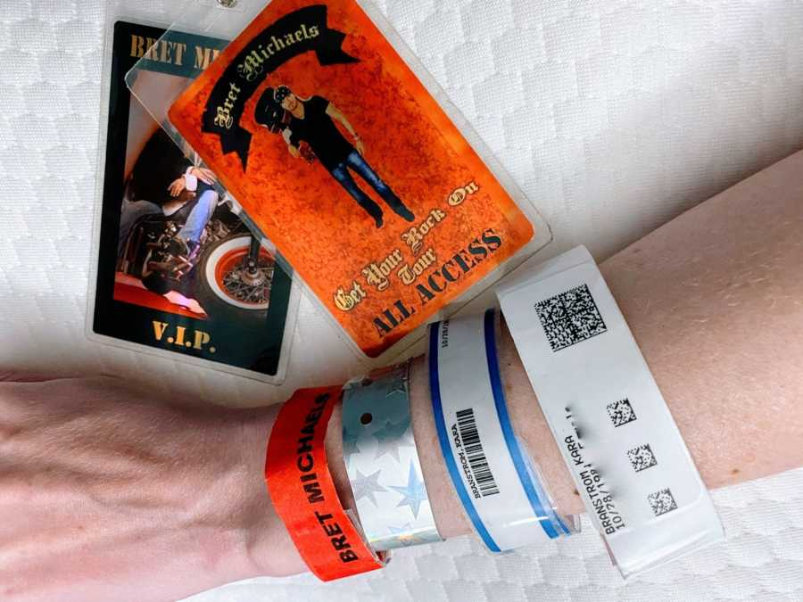 Woman takes photos of V.I.P backstage concert passes for Bret Michaels along with her hospital band