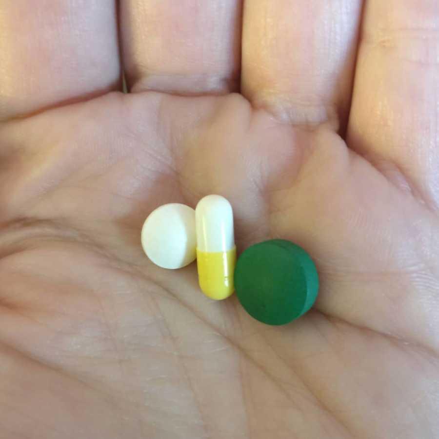antibiotics in hand