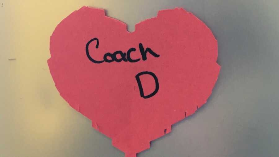 Red heart with Coach D written on it