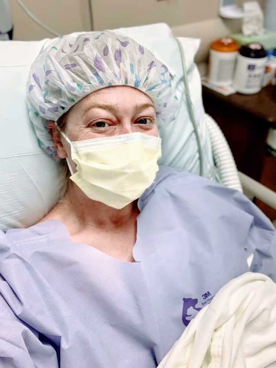 Woman battling lupus and multiple infections takes a selfie in full hospital gear