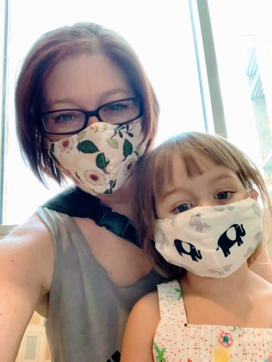 Woman with lupus takes a selfie with her daughter while they both wear masks during the Coronavirus pandemic