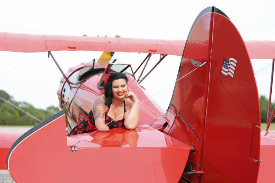 woman in a red airplane