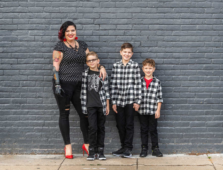 woman with prosthetic arm and her three kids