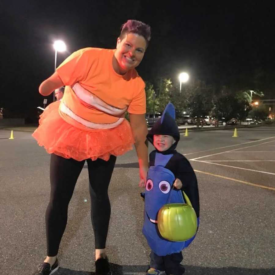 mom with 1 arm and son in Halloween costumes