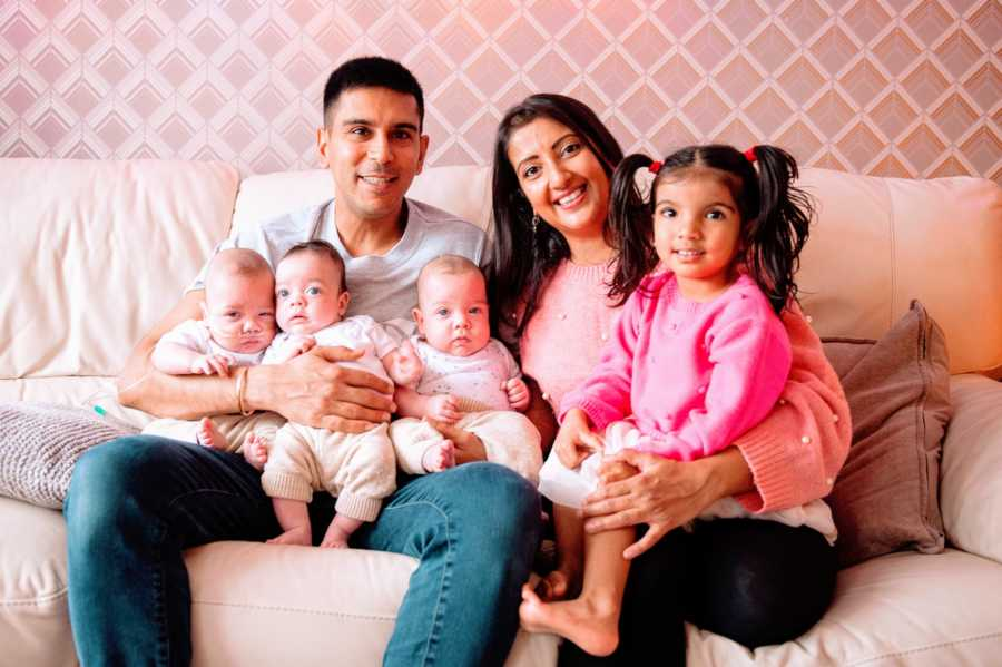 Family of six take pink-themed family photo with their children conceived through surrogacy