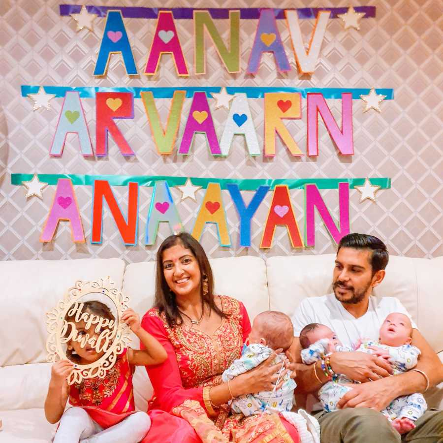 Indian couple celebrate Diwali with their 3-year-old daughter and newborn triplet sons