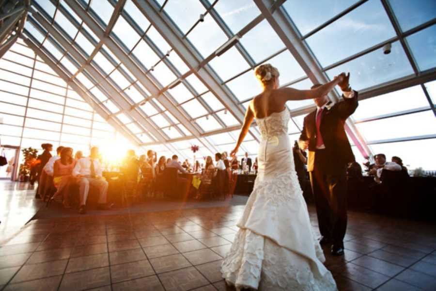 A bride and groom dance at a wedding