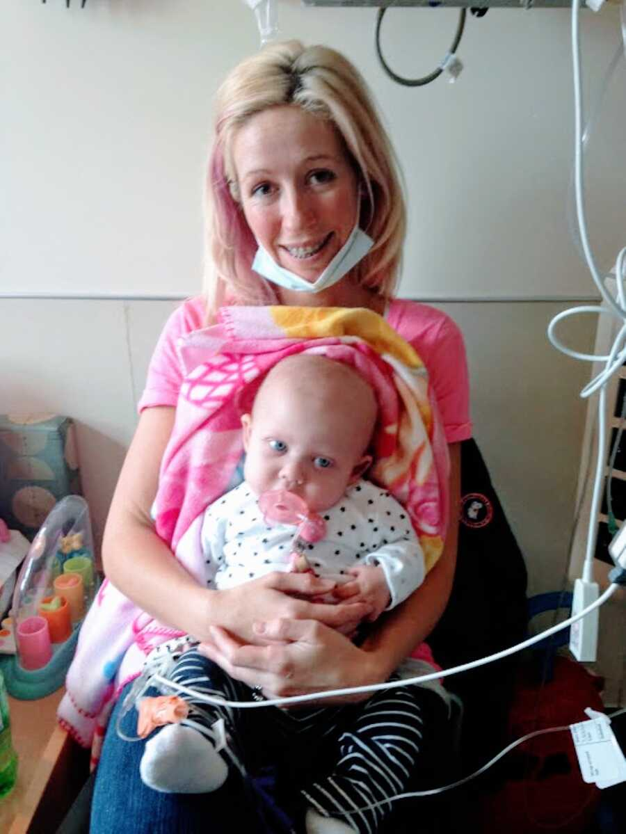New mom holds her daughter born with no immune system while she's living in the hospital