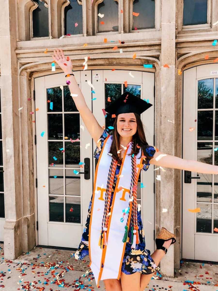 girl in graduation cap with confetti